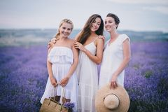 Three women posing in a lavender field Royalty Free Stock Photos