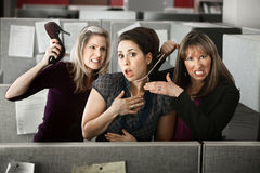 Three Women Quarreling In Office stock photos