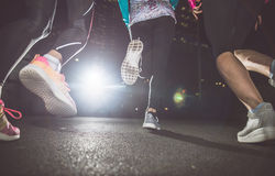 Three women running in the night. In the city center royalty free stock images