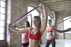 Three Women's Doing Exercises Royalty Free Stock Photo