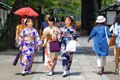 Three women's kimonos at Fushimi Inari Shrine Stock Photo