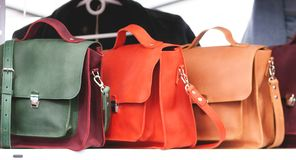 Three Women`s Leather Handbags Royalty Free Stock Images