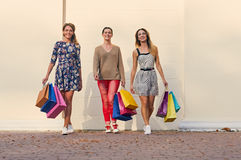Three Women with Shopping Bags on walk Stock Photos