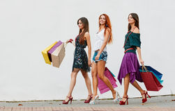 Three Women with Shopping Bags Royalty Free Stock Photography