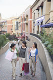 Three Women In Shopping Mall Royalty Free Stock Images