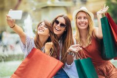 Women shopping together and make selfie photo. Three women shopping together and make selfie photo stock photo