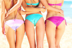 Three women showing their back in bikini Royalty Free Stock Image