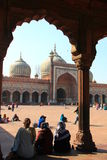 Three women sitting in front of Jama Masjid/Mosque Royalty Free Stock Photo