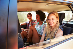 Three Women Sitting In Rear Seat Of Car On Road Trip Stock Photography