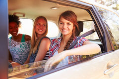 Three Women Sitting In Rear Seat Of Car On Road Trip Royalty Free Stock Photo