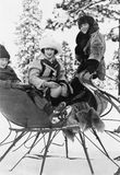 Three women sitting in a sled Stock Photos