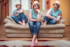 Three women sitting on the sofa Stock Photos