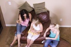 Three Women Socializing at Home. Three Females Socializing at Home Stock Image