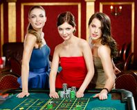 Three women stake playing roulette Stock Images