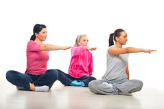 Three women stretching hands. Three women sitting with legs crossed and side stretching hands over white background Stock Images