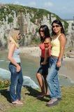 Three women taking chimarrão on Torres beach stock photo