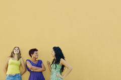 Three women talking and having fun stock images