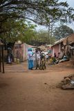 Three women talking on a street at the Missira neighborhood, in the city of Bissau. Bissau, Republic of Guinea-Bissau - February 6, 2018: Three women talking on stock photo