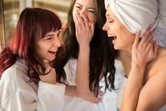 Three women in towels having fun together royalty free stock photos
