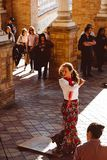 Three women in traditional costumes dance spanish flamenco on the plaza de Espana on February 2019 in Seville royalty free stock images