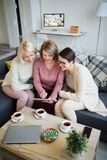 Three Women Using Digital Tablet stock photos