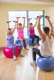Three women using weights Stock Photos