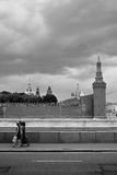Three women walk along the Moscow river. Stock Images