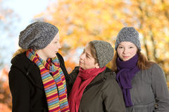 Three women walk forest fall Stock Image