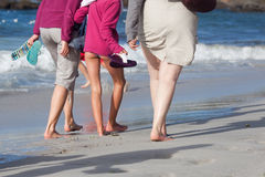 Three women walking at the beach Royalty Free Stock Photography