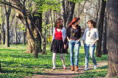 Three women walking in the park Royalty Free Stock Images