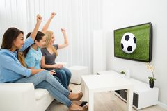 Three women watching football match Stock Photography