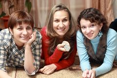 Three women watching television Royalty Free Stock Photos