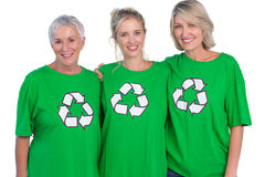 Three women wearing green recycling tshirts smiling at camera Stock Images