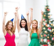 Three women wearing hats and showing thumbs up Stock Images