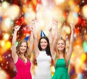 Three women wearing hats and showing thumbs up Stock Photo
