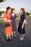 Three women wearing old fashioned 1940s dresses Stock Photo