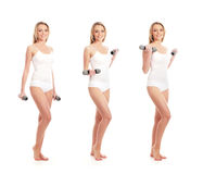 Three women in white clothes holding dumbbells Stock Photo