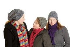 Three women woolen cap scarf Royalty Free Stock Photo
