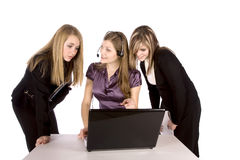 Three women working on computer Stock Image