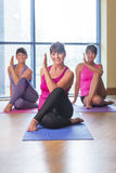 Three women in a yoga pose Stock Photo