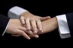 Three womens hands. In a gesture of team work three young multi-ethnic business woman join hands royalty free stock photos
