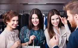 Three wonderful women talk with salesperson Stock Photography