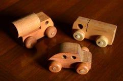 Three Wood Cars Royalty Free Stock Photography