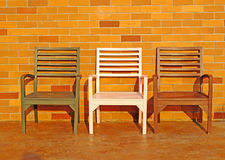 Wood chairs and brick wall Royalty Free Stock Photography
