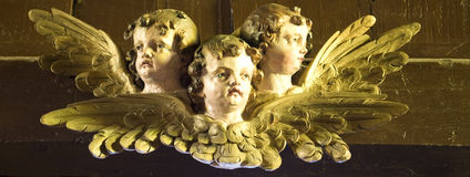 Three wooden angels. A group of three wooden carving angels stock image