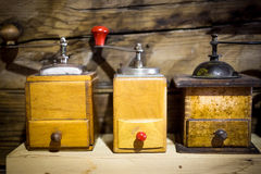 Three wooden antique coffee mills Stock Photography