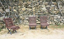 Three wooden benches on the park Stock Photo
