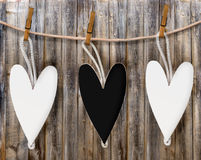 Three wooden black and white heart hang Stock Images
