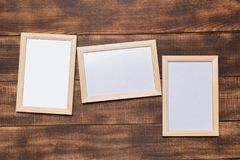 Blank frame on a wooden background royalty free stock images