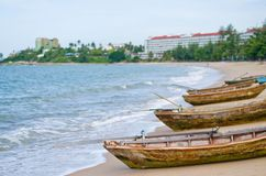 Three wooden boats on the beach royalty free stock photography